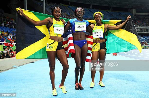 Elaine Thompson of Jamaica Tori Bowie of the United States and ShellyAnn FraserPryce of Jamaica celebrates after the Women's 100m Final ahead of on...