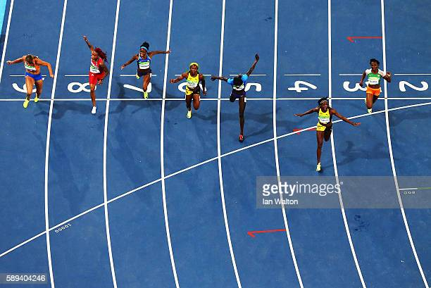 Elaine Thompson of Jamaica wins the Women's 100m Final ahead of Tori Bowie of the United States and Shelly-Ann Fraser-Pryce of Jamaica on Day 8 of...