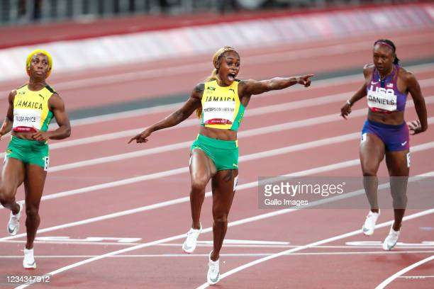 Elaine Thompson-Herah of Jamaica wins the womens 100m final during the Athletics event on Day 8 of the Tokyo 2020 Olympic Games at the Olympic...