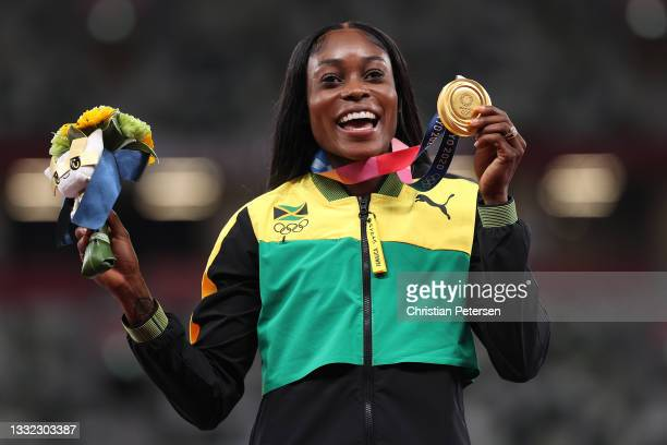 Elaine Thompson-Herah of Team Jamaica poses with the gold medal for the Women's 200m Final on day twelve of the Tokyo 2020 Olympic Games at Olympic...