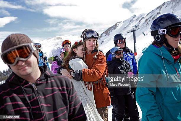 Elaine Vardamis of Nederland Co is embraced by her husband Dan Vardamis as the couple renews their vows at Loveland Ski Area in Colorado at the 20th...