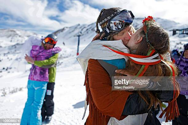 Elaine Vardamis of Nederland Co is kissed by her husband Dan Vardamis as the couple renews their vows with other couples atop Loveland Ski Area in...