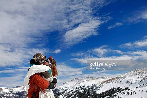 Elaine Vardamis of Nederland Co kisses her husband Dan Vardamis after the couple renewed their vows at Loveland Ski Area in Colorado at the 20th...