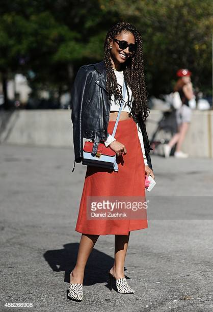 Elaine Welteroth is seen outside the 31 Phillip Lim show wearing a Theory white top Miu Miu red skirt and Jenni Kayne shoes during New York Fashion...