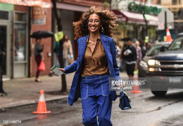 Elaine Welteroth is seen wearing a blue suit and leopard print top outside the 31 Phillip Lim show during New York Fashion Week Women's S/S 2019 on...
