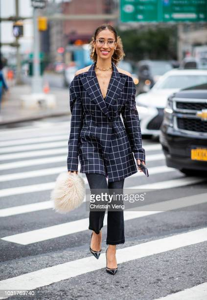 Elaine Welteroth wearing fluffy bag cropped denim jeans checked blazer is seen outside Oscar de la Renta during New York Fashion Week Spring/Summer...