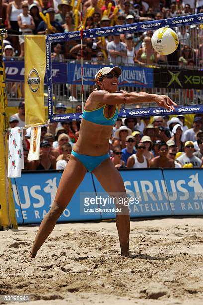 Elaine Youngs sets the ball during the AVP Hermosa Beach Open at the Hermosa Beach Pier on July 24, 2005 in Hermosa Beach, California.