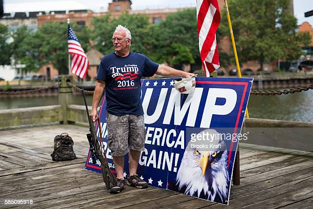 Elam Stoltzhus s supporter of Republican Presidential candidate Donald Trump holds a riffle at an 'America First' unity rally July 18 2016 in...