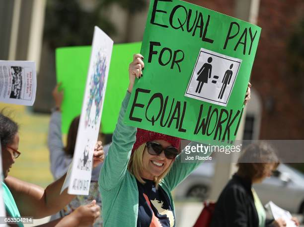 Elana Goodman joins with other protesters to ask that woman be given the chance to have equal pay as their male coworkers on March 14 2017 in Fort...