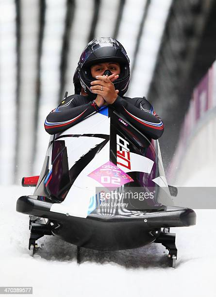 Elana Meyers and Lauryn Williams of the United States team 1 react during the Women's Bobsleigh on Day 12 of the Sochi 2014 Winter Olympics at...