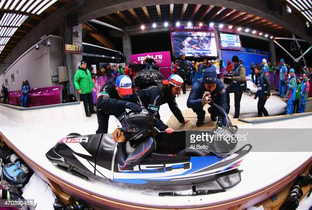 Elana Meyers and Lauryn Williams of the United States team 1 react after failing to take the gold medal during the Women's Bobsleigh on Day 12 of the...
