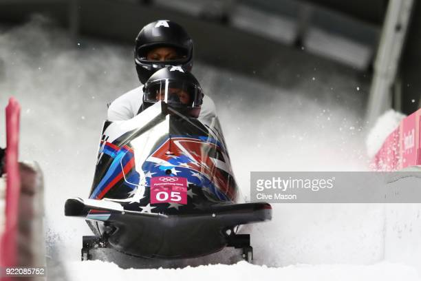 Elana Meyers Taylor and Lauren Gibbs of the United States celebrate in the finish area during the Women's Bobsleigh heats on day twelve of the...