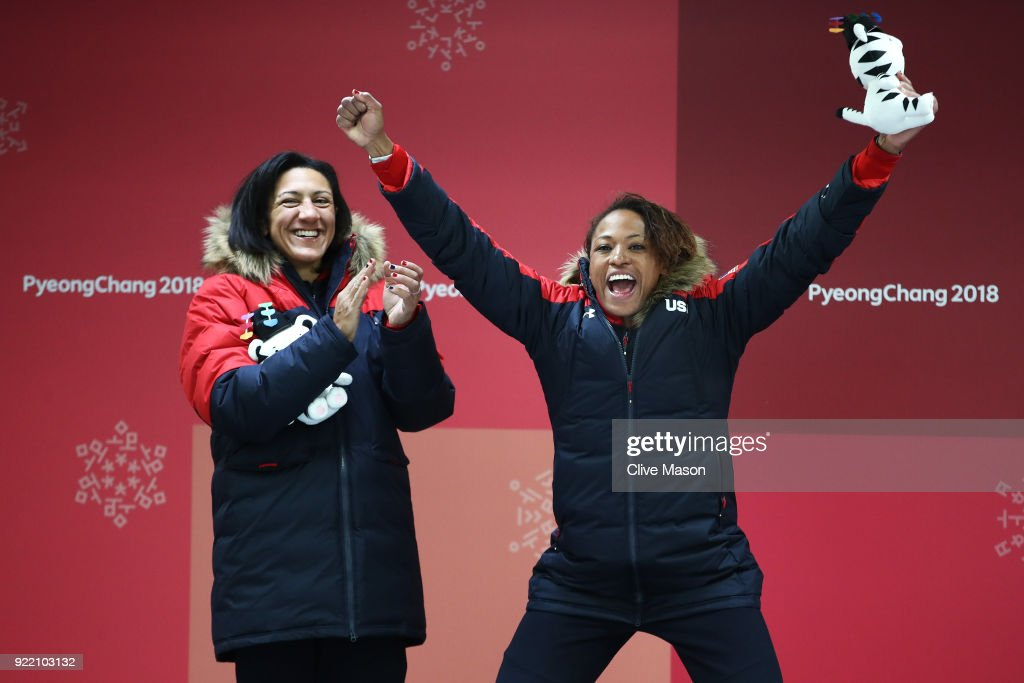 Elana Meyers Taylor (L) and Lauren Gibbs of the United States celebrate winning silver during the Women's Bobsleigh heats on day twelve of the PyeongChang 2018 Winter Olympic Games at the Olympic Sliding Centre on February 21, 2018 in Pyeongchang-gun, South Korea.