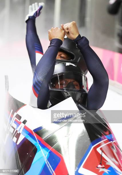 Elana Meyers Taylor and Lauren Gibbs of the United States react in the finish area during the Women's Bobsleigh heats on day twelve of the...