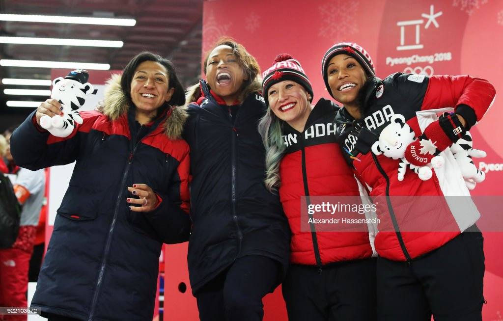 Elana Meyers Taylor and Lauren Gibbs of the United States, silver, and Kaillie Humphries and Phylicia George of Canada, bronze, celebrate after the Women's Bobsleigh heats on day twelve of the PyeongChang 2018 Winter Olympic Games at the Olympic Sliding Centre on February 21, 2018 in Pyeongchang-gun, South Korea.