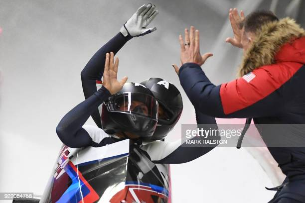 Elana Meyers Taylor and US Lauren Gibbs compete in the women's bobsleigh heat 4 final run during the Pyeongchang 2018 Winter Olympic Games at the...