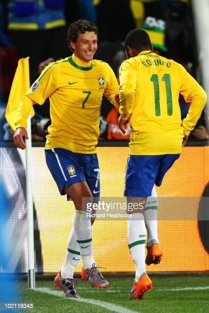 Elano of Brazil celebrates with team mate Robinho after he scores his side's second goal during the 2010 FIFA World Cup South Africa Group G match...