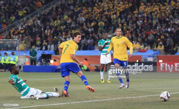 Elano of Brazil scores his side's third goal during the 2010 FIFA World Cup South Africa Group G match between Brazil and Ivory Coast at Soccer City...
