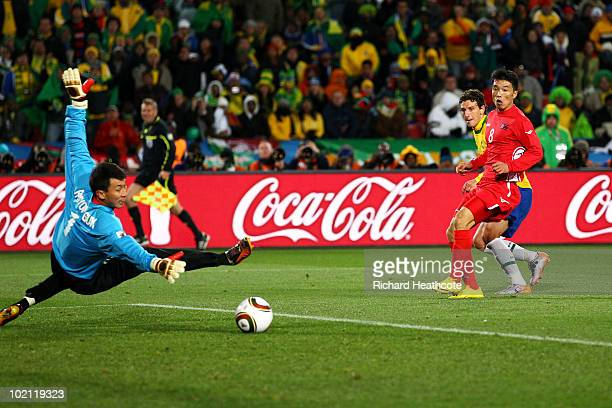 Elano of Brazil scores the second goal during the 2010 FIFA World Cup South Africa Group G match between Brazil and North Korea at Ellis Park Stadium...