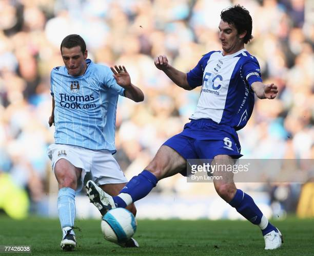 Elano of Manchester City tackles Liam Ridgewell of Birmingham City during the Barclays Premier League match between Manchester City and Birmingham...