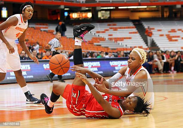 Elashier Hall of the Syracuse Orange reaches for the ball on the court against Erica Wheeler of the Rutgers Scarlet Knights during the game at the...