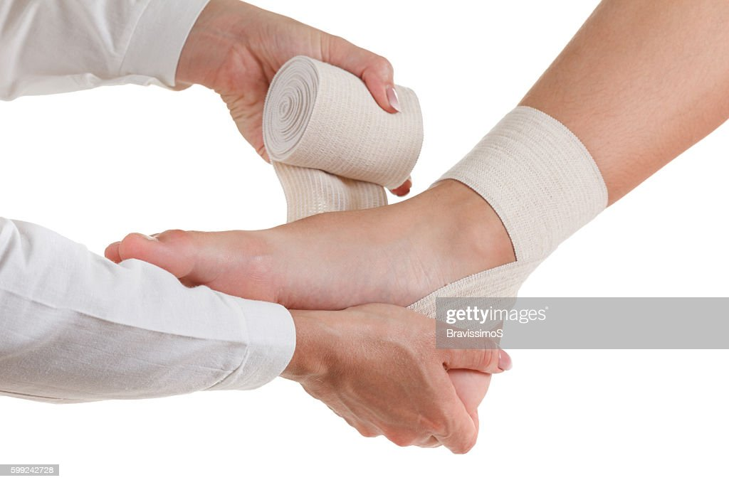 Elastic supportive orthopedic bandage, compression stabilizer ankle, isolated on white : Stock Photo