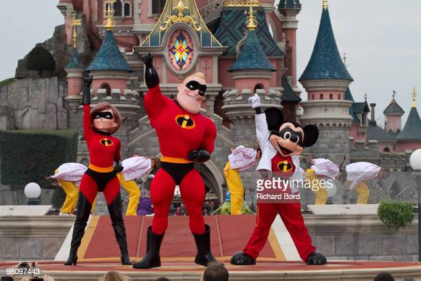 Elastigirl, Mr Indestructible and Mickey perform during a show in the front of the Cinderella Castle during the New Generation Year Launch at...