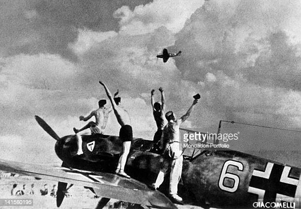 Elated German army pilots greet a bomber's return to base after a mission in the Dnipropetrovsk area Ukraine August 1941