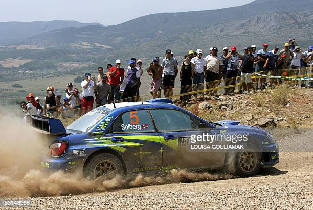 Petter Solberg of Norway speeds up his Subaru Impreza at the Elatia special stage of the Leg 1 of the WRC Rally Acropolis 24 June 2005 AFP...