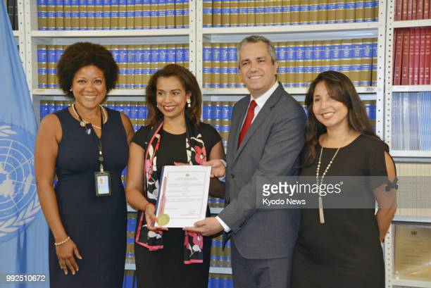 Elayne Whyte Gomez Costa Rican ambassador to the UN Office in Geneva poses at UN headquarters in New York on July 5 after filing documents to ratify...