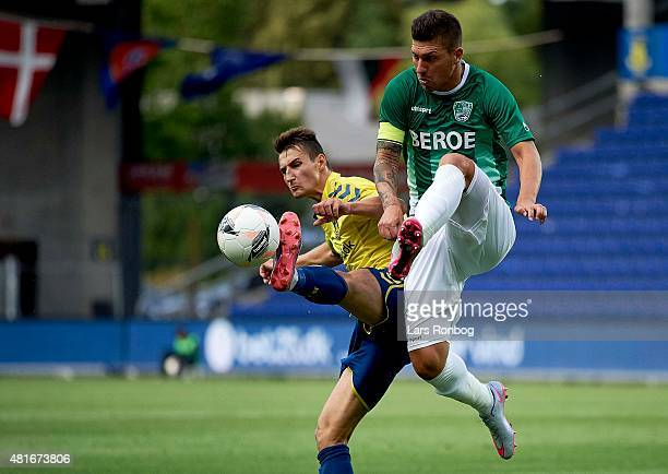 Elbasan Rashani of Brondby IF and Ivo Ivanov of PFC Beroe Stara Zagora compete for the ball during the UEFA Europa League Qualification match between...