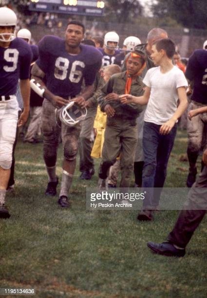 Elbert Kimbrough of the Northwestern Wildcats walks off the field after an NCAA game against the Oklahoma Sooners on September 26, 1959 at Dyche...