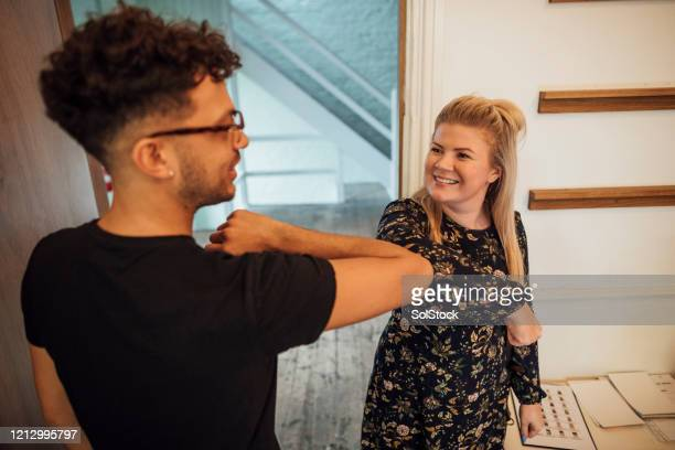 elbow bump - alternative pose stock pictures, royalty-free photos & images