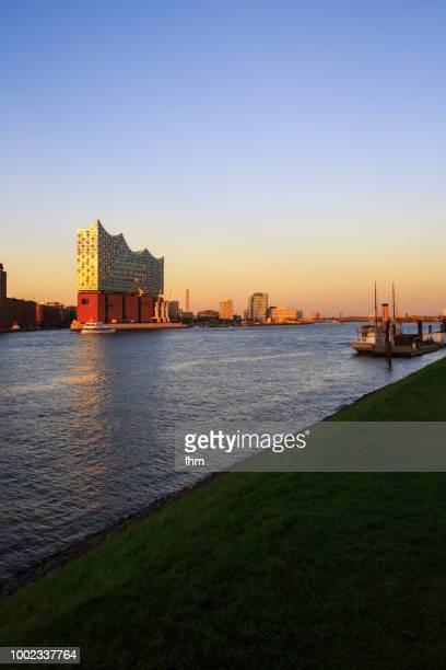 elbphilharmonie hamburg at sunset (germany) - elbphilharmonie stock pictures, royalty-free photos & images