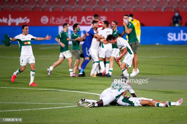 Elche CF players celebrate their victory after the La Liga Smartbank Playoffs match between Girona FC and Elche CF at Montilivi Stadium on August 23...