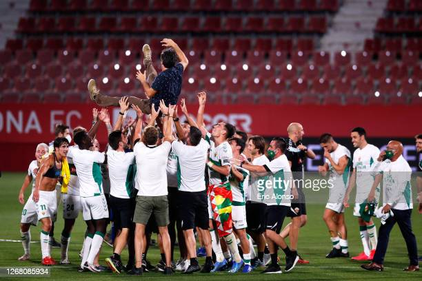 Elche CF players toss Head Coach Jose Rojo Martin 'Pacheta' after the La Liga Smartbank Playoffs match between Girona FC and Elche CF at Montilivi...