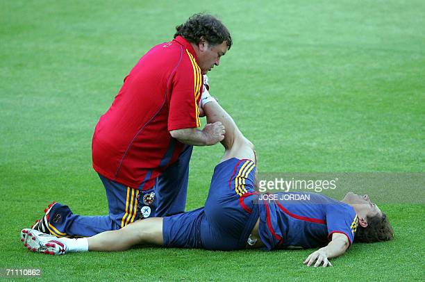 Spain?s national football team player Michel Salgado is helped by atendent Jesus Paredes during a trainning session at Martinez Valero satdium in...