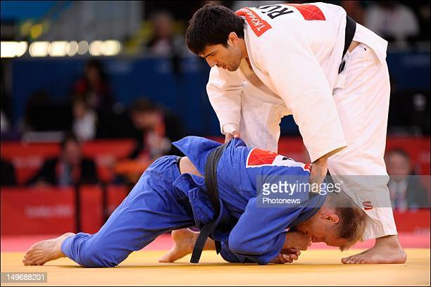 Elco Van Der Geest of Belgium competes with Tagir Khaibulaev of Russia during the Judo Men 100 kg Elimination Round of 32 match on Day 6 of the...