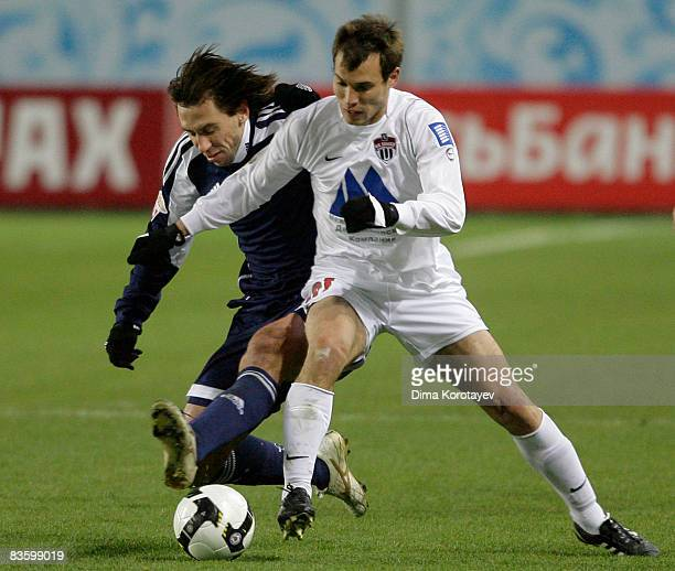 Eldar Nizamutdinov of FC Khimki in action with Valeri Klimov of FC Tom Tomsk during the Russian Football League Championship match between FC Khimki...