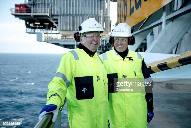 Eldar Saetre chief executive officer of Equinor ASA left and Arne Sigve Nylund head of development and production in Norway for Equinor ASA pose for...