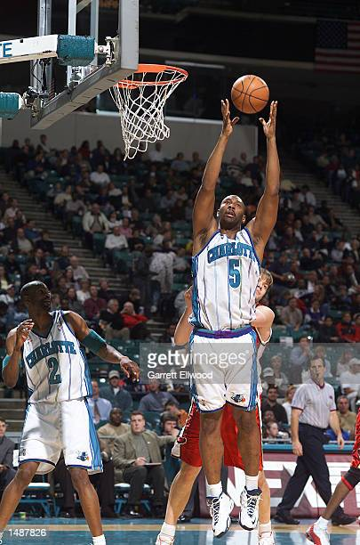 Elden Campbell of the Charlotte Hornets grabs another rebound against the Atlanta Hawks during a NBA game at the Charlotte Coliseum in Charlotte...