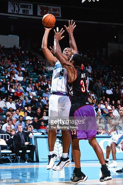 Elden Campbell of the Charlotte Hornets shoots against Antonio Davis of the Toronto Raptors during the game on November 29 2000 at Charlotte Coliseum...