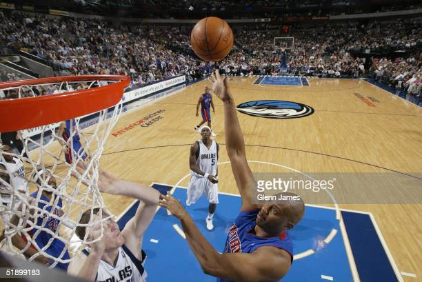 Elden Campbell of the Detroit Pistons shoots during the game against the Dallas Mavericks on December 6 2004 at the American Airlines Center in...