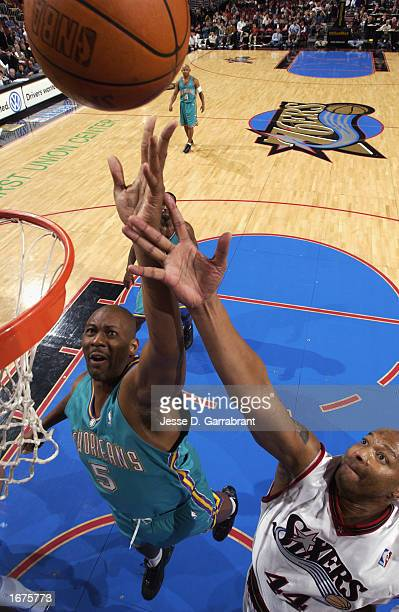 Elden Campbell of the New Orleans Hornets and Derrick Coleman of the Philadelphia 76ers battle for a rebound during the NBA game at First Union...
