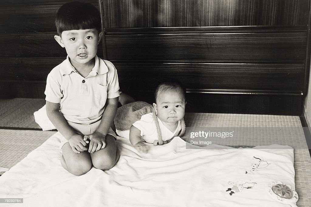 Elder brother and a baby : Stock Photo