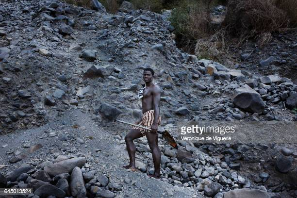 Elder is a sand looter He is taking the sand out from the sea with a shovel Beach sand is a valuable construction material and in a country with...