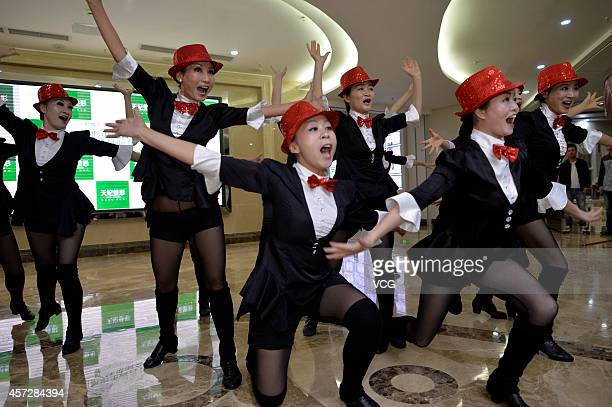 Elder ladies from Aibo Performing Art Troupe rehearse dance for boarding the stage of CCTV New Year's Gala at a cosmetic surgery hospital on October...