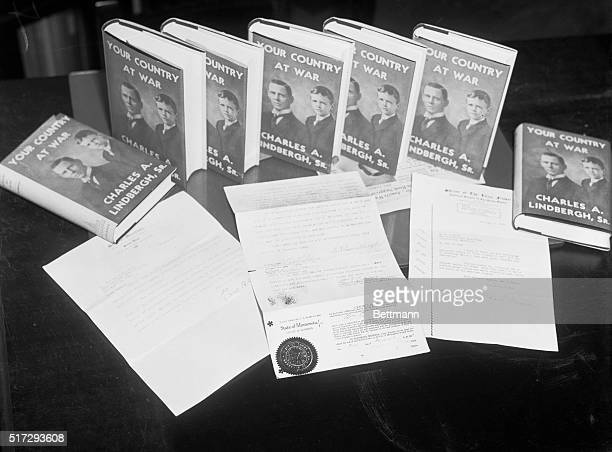 Elder Lindbergh's book is shown-- Your Country at War. This book written by the late Congressman Charles A. Lindbergh, father of Colonel Lindbergh,...