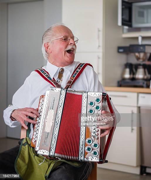 Elder man with accordion