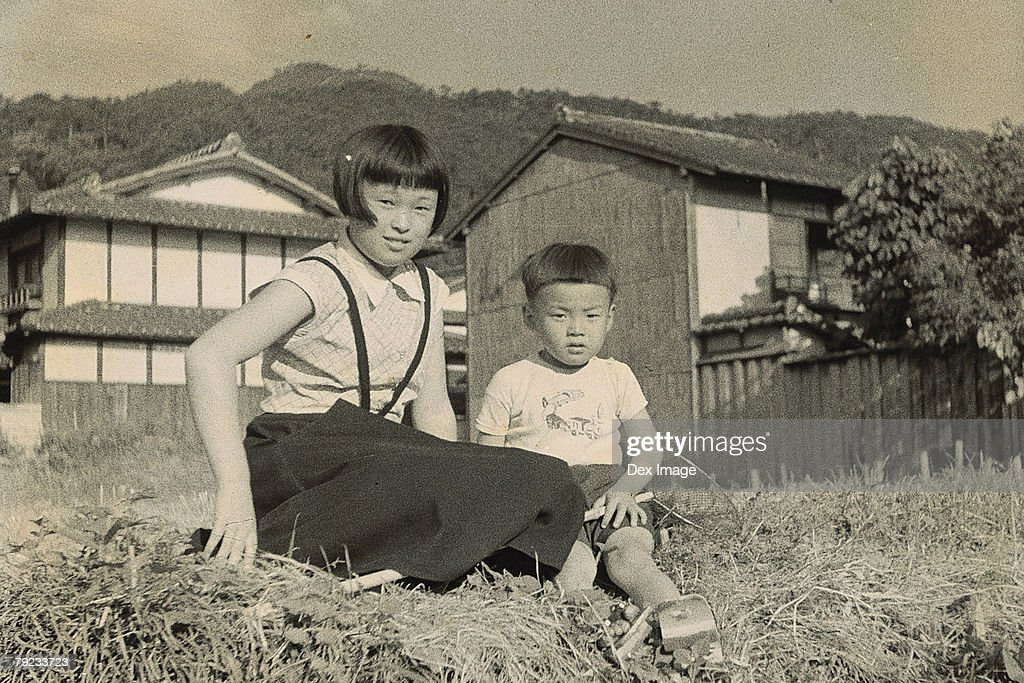 Elder Sister and younger brother at the backyard : Stock Photo